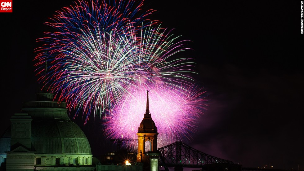 """This beautifully composed photo of the Montreal skyline was taken by Mark Connor from the rooftop of a friend's apartment block during the <a href=""""http://ireport.cnn.com/docs/DOC-996683"""" target=""""_blank"""">annual Montreal fireworks competitions</a>. The photo shows the Jacques Cartier Bridge, the Old Palace de Justice and the old Town Hall."""