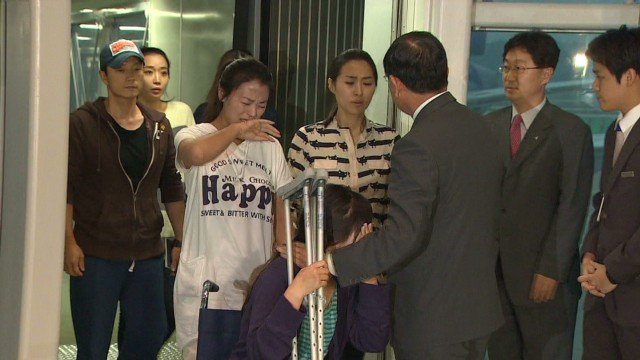 Asiana flight attendants return home