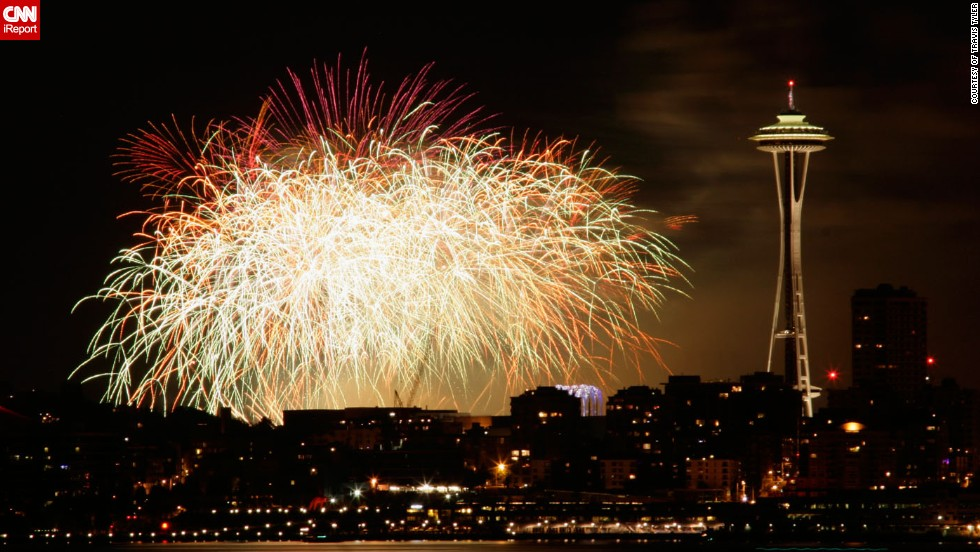 """Travis Tyler captured this stunning moment when fireworks lit up the skies over <a href=""""http://ireport.cnn.com/docs/DOC-996610"""" target=""""_blank"""">Seattle</a> on Fourth of July in 2009. Travis was standing on Alki Beach in West Seattle and had the perfect view of the iconic Space Needle."""