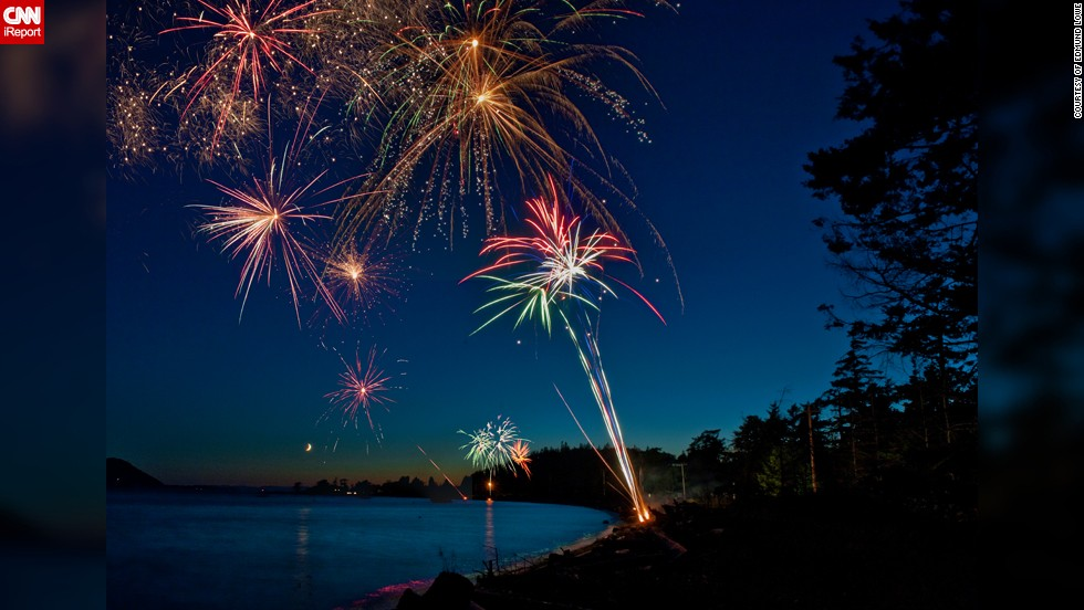 "Photographer Edmund Lowe captured this stunning photo of the fireworks over <a href=""http://ireport.cnn.com/docs/DOC-996606"">Legoe Bay, Lummi Island in Washington State</a> on the Fourth of July in 2011. ""Fireworks make adults turn into kids again,"" he says. He also has some great tips for those wanting to capture iconic fireworks shots: <br /><br />""The main requirement is a tripod, I use a sandbag or some other heavy object to make sure there is no tripod shake. Long exposures, up to ten seconds are required. I generally use an f-stop of f/11 to f/16 and a shutter speed of two-ten seconds. The longer exposures will also give you time for multiple reports to be visible. This fills the sky with the sparkles."""