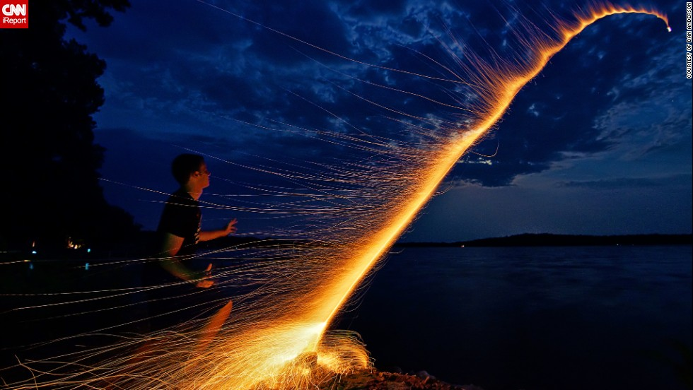 "Dan Anderson managed to capture the moment his nephew launched a bottle rocket across one of Minnesota's many lakes, <a href=""http://ireport.cnn.com/docs/DOC-996552"">Lake Kronis</a>, during the Fourth of July in 2012. They had carefully prepared everything to take the perfect photo, counting the seconds it took from lighting the fuse to the explosion of the firework and arranging the camera on a tripod. ""We did it in one take and then ran away because the mosquitoes were eating us alive,"" he says."