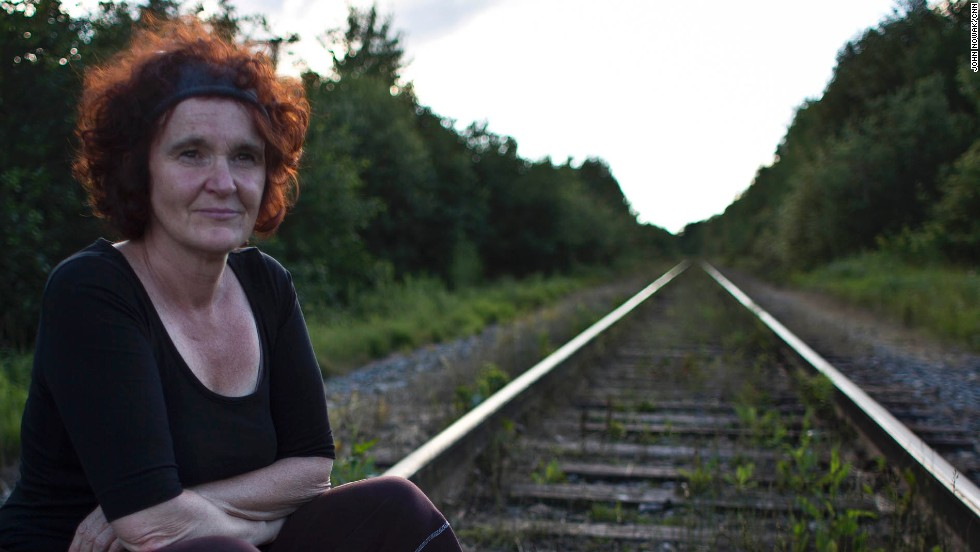 Luce Robineau, on the train tracks directly behind her home, lost her business in the derailment. She operated a boutique downtown and hopes to rebuild.