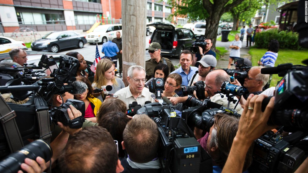 Ed Burkhardt, CEO of Montreal, Maine & Atlantic Railway, spoke to media in Lac-Megantic on Wednesday, July 10, four days after the train wreck. He was heckled by onlookers, and many residents say he has mishandled the ordeal.