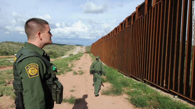 A proposal to put razor wire atop parts of the border fence near Nogales, Arizona, shown here in 2010, faces opposition.