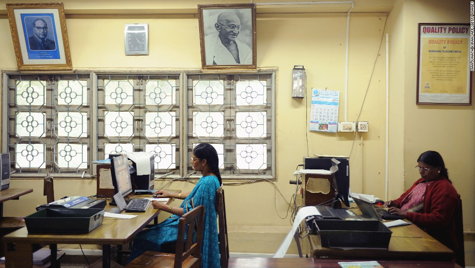 Employees feed in telegram messages onto computers to be sent via telegram in Bangalore on June 13.