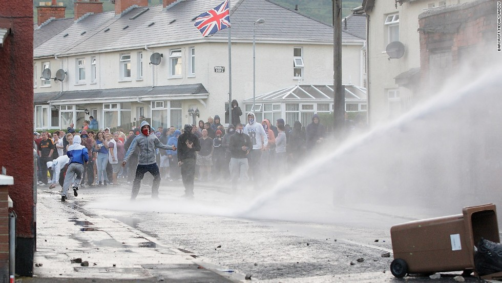 Police fire a water cannon at a crowd on July 13.