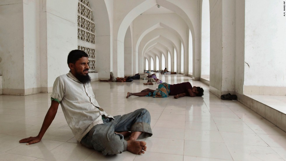 Muslims rest at a mosque in Dhaka, Bangladesh, on Sunday, July 14.