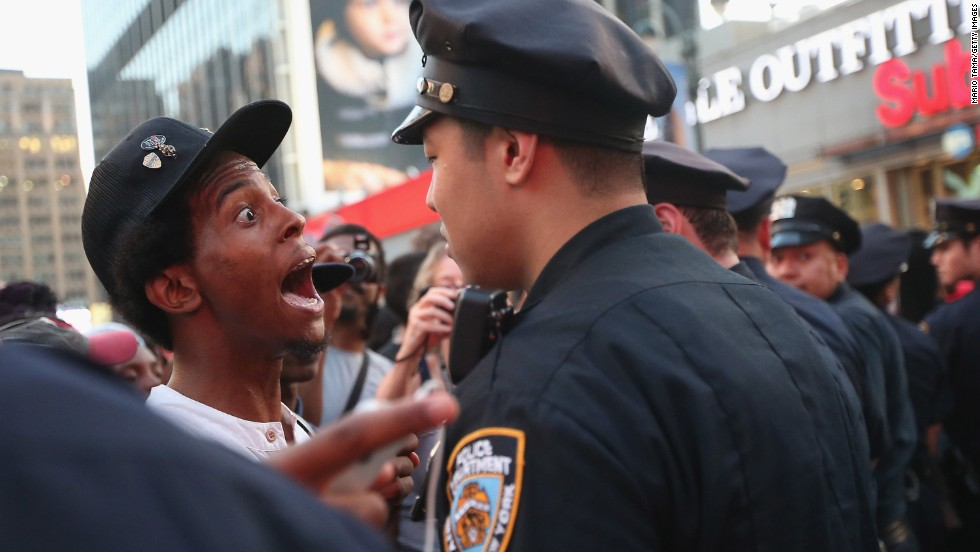 A man argues with a police officer as supporters of Trayvon Martin march while blocking traffic in Union Square in New York on Sunday, July 14.
