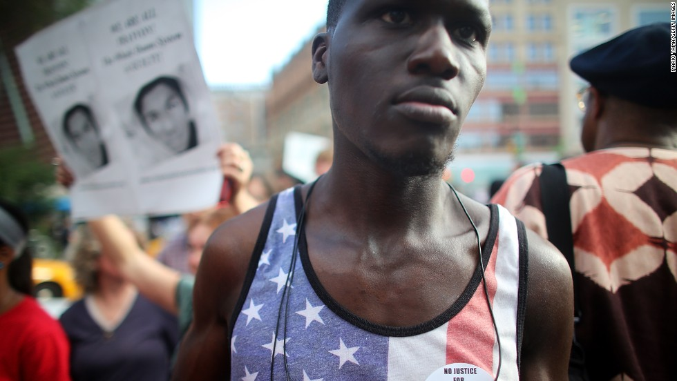 """JULY 15 - NEW YORK, NY: <a href=""""http://cnn.com/2013/07/15/justice/zimmerman-verdict-protests/index.html?hpt=hp_t1"""">Rallies honoring Trayvon Martin</a> took place across the U.S. after a Florida jury <a href=""""http://cnn.com/2013/07/13/justice/zimmerman-trial/index.html?iid=article_sidebar"""">acquitted</a> George Zimmerman of all charges in the shooting death of Martin on July 13. Many protesters questioned the verdict in the trial, which became a forum for <a href=""""http://cnn.com/2013/07/05/justice/zimmerman-jury-millions/index.html?iid=article_sidebar"""">debate about gun laws and race in America</a>."""