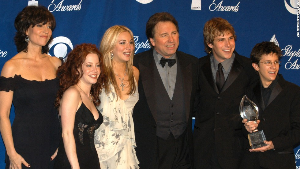 "John Ritter, center -- shown here with ""8 Simple Rules"" cast mates (from left) Katey Sagal, Amy Davidson, Kaley Cuoco, Billy Aaron Brown and Martin Spanjers -- died of an aortic dissection at the height of the show in 2003. His character also died on the show and two additional cast members, David Spade and James Garner, were cast after a hiatus."