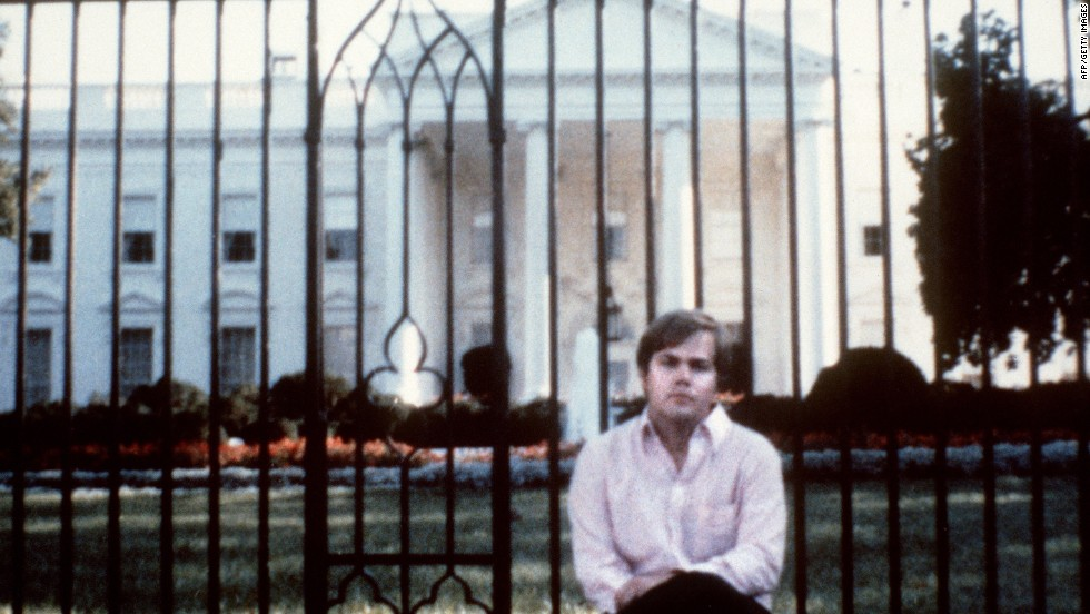 Hinckley poses for a photo in front of the White House. A federal judge committed Hinckley to St. Elizabeth's Hospital after a jury found him not guilty by reason of insanity in the spring of 1982.