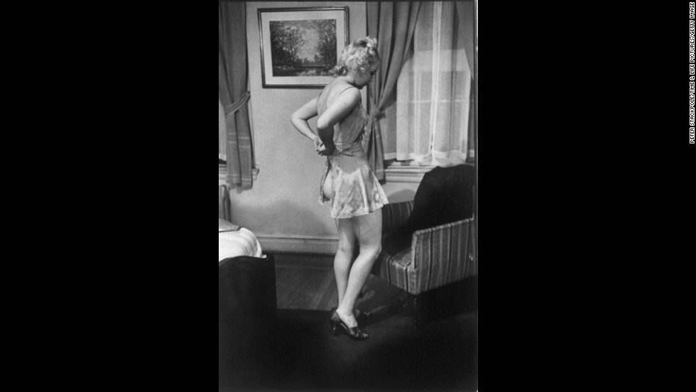 St. Clair demonstrates a correct method of undressing.