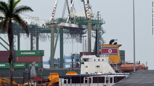 Panamanian inspectors are examining containers on a North Korean ship after weapons were found, officials say.