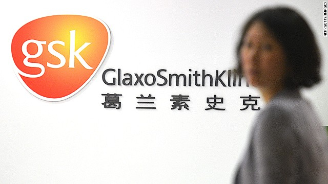 An employee of British drug firm GlaxoSmithKline (GSK) enters their office headquarters in Shanghai on July 1, 2013.