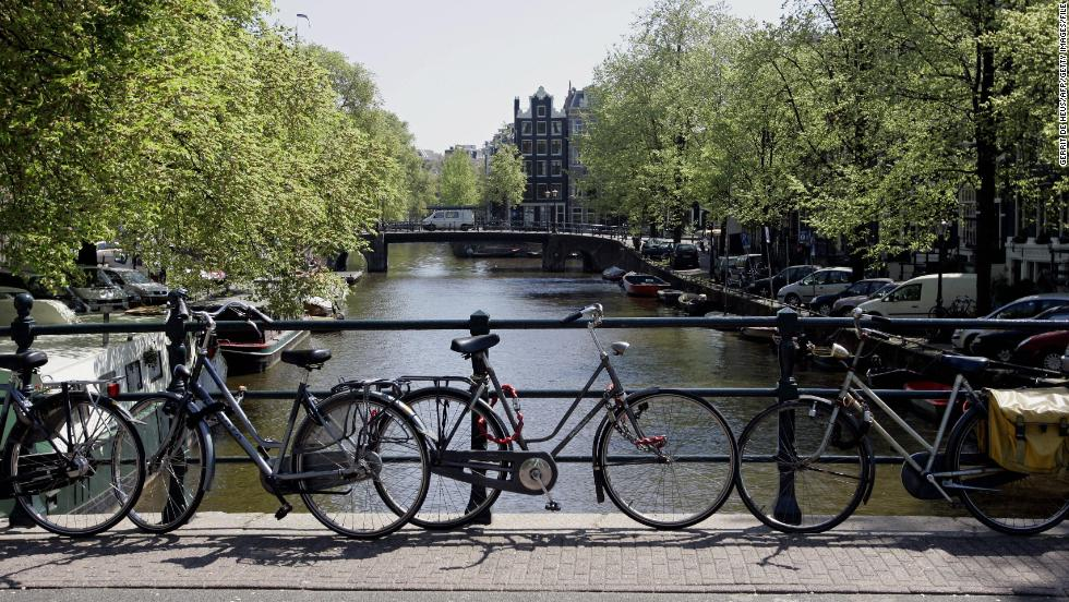 Lovely canals and a vibrant cycling society are part of what defines Amsterdam. The city also has a global reputation for tolerance.