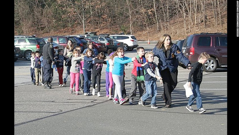 "Connecticut State Police evacuate children from <a href=""http://www.cnn.com/2012/12/14/us/connecticut-school-shooting/index.html"" target=""_blank"">Sandy Hook Elementary School</a> in Newtown, Connecticut, on December 14, 2012. Adam Lanza opened fire in the school, killing 20 children and six adults before killing himself. Police say he also shot and killed his mother in her Newtown home."