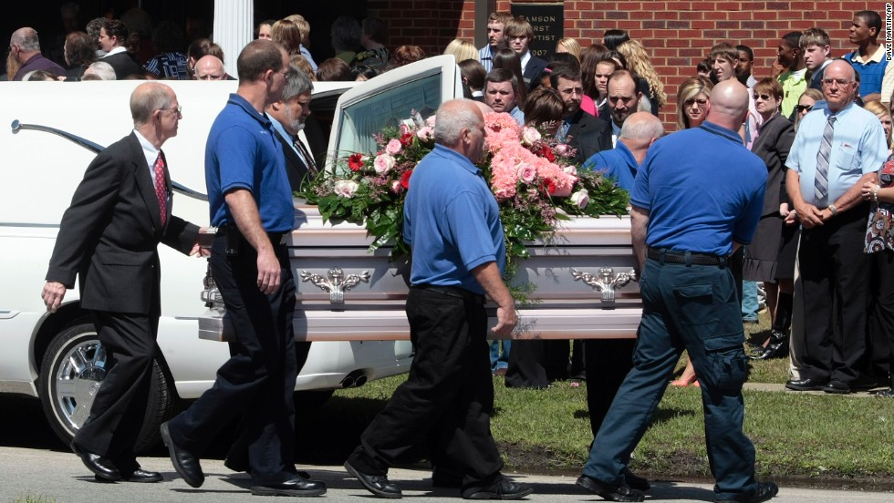 "Pallbearers carry a casket of one of <a href=""http://www.cnn.com/2009/CRIME/03/11/alabama.shooting.timeline/index.html?iref=allsearch"" target=""_blank"">Michael McLendon's</a> 10 victims. McLendon shot and killed his mother in her Kingston, Alabama, home, before shooting his aunt, uncle, grandparents and five more people. He shot and killed himself in Samson, Alabama, on March 10, 2009. McClendon left a note saying he put his mother ""out of her misery."""