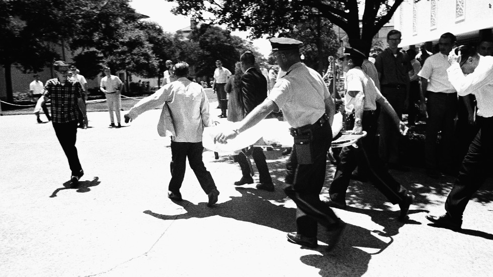 Officers in Austin, Texas, carry victims across the University of Texas campus after Charles Joseph Whitman opened fire from the school's tower, killing 16 people and wounding 30 in 1966. Police officers shot and killed Whitman, who had killed his mother and wife earlier in the day.
