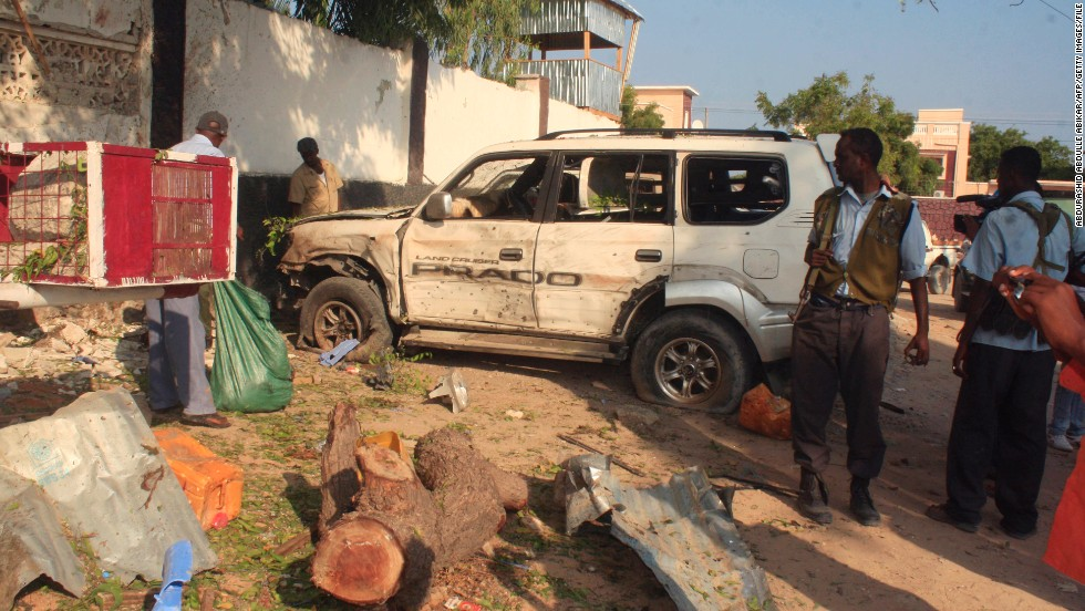 "Despite the relatively peaceful business environment, insurgents still launch sporadic attacks. Jamal's restaurants have also been targeted. Pictured, Somali security forces stand near the debris left after two suicide bombers attacked one of ""The Village"" restaurants on November 3, 2012."