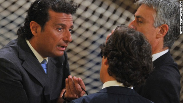 Costa Concordia captain Francesco Schettino speaks with officials before his trial Wednesday in Grosseto.