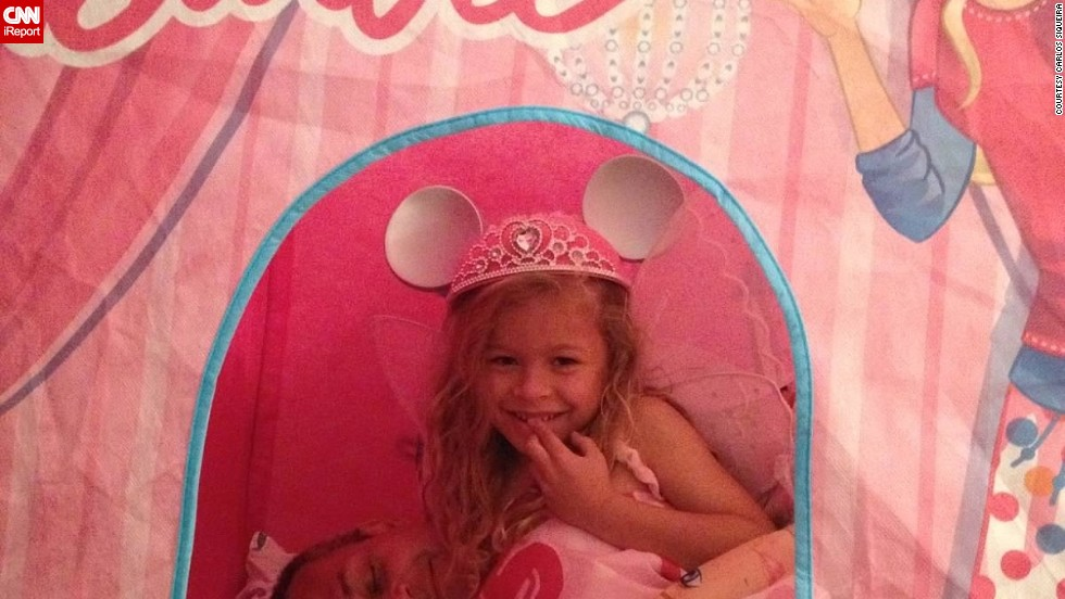 """Even though IT consultant Carlos Siqueira works in another state, he tries to take an active role in his 6-year-old daughter's life. That includes sleeping in her Barbie tent. (<a href=""""http://ireport.cnn.com/docs/DOC-1005619"""">Read his story.</a>)"""