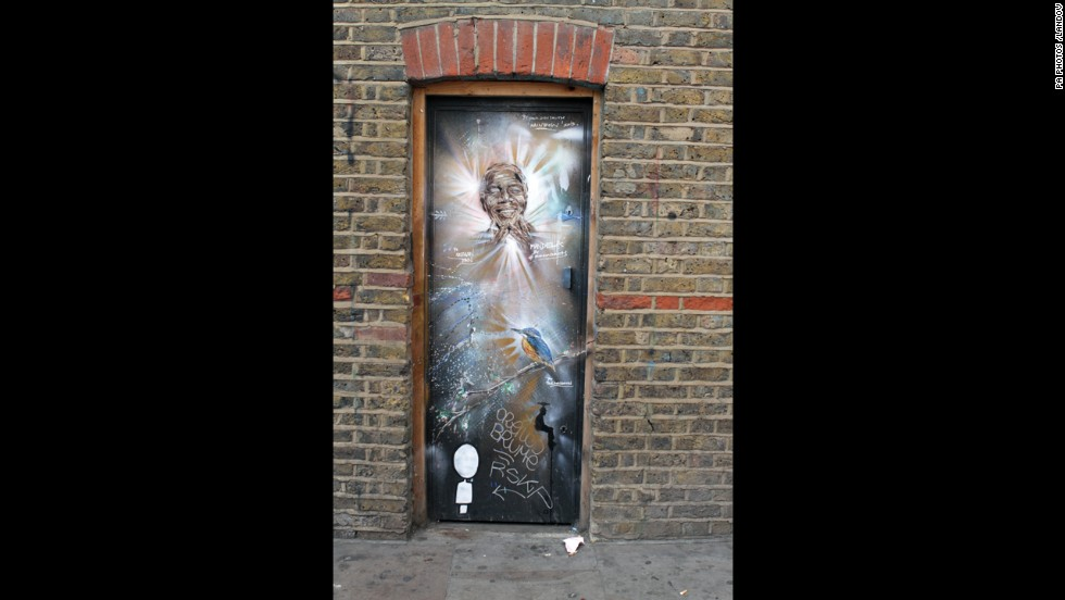 <strong>ENGLAND: </strong>Graffiti of Mandela by Paul Don Smith is seen on a door in East London.