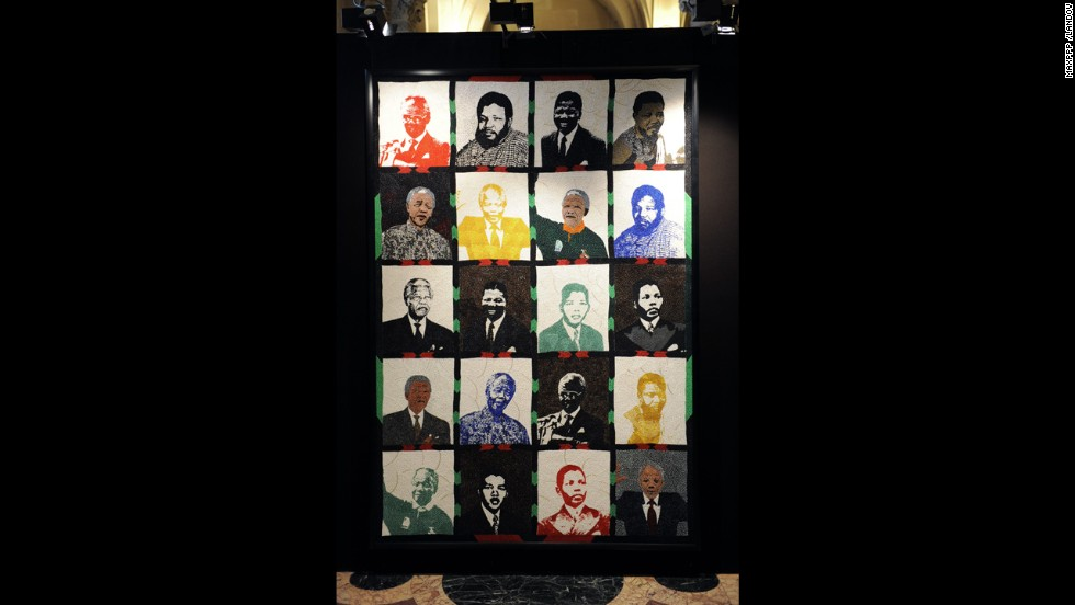 <strong>FRANCE: </strong>Artwork featuring Mandela over the years is on display at an exhibition in Paris.