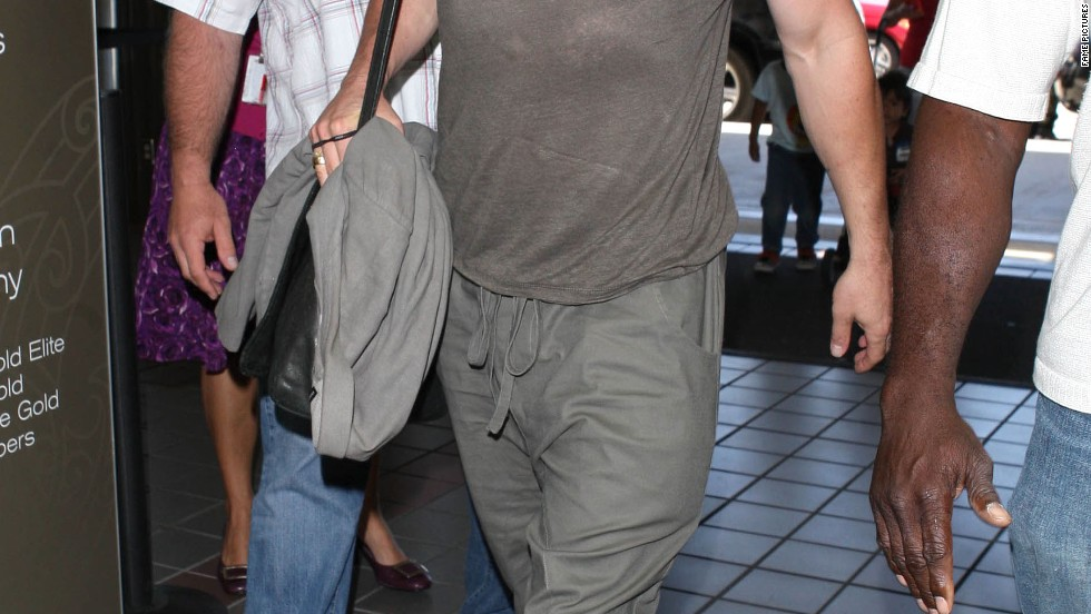"Brad Pitt looks ready for ""World War Z"" as he gets off a flight on July 16."