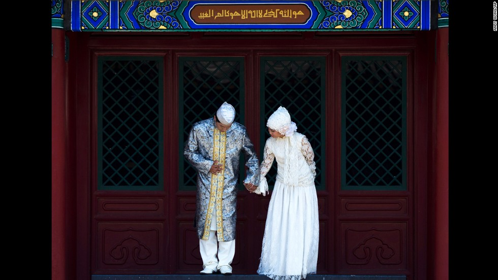 A pair of newlyweds prepare to pose for wedding photos at Niujie Mosque in Beijing on July 16.