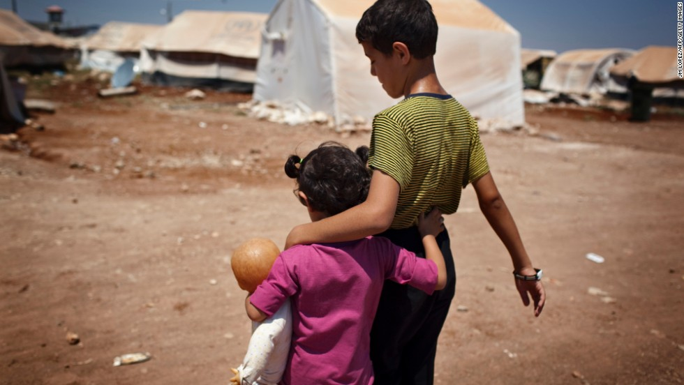 Syrian refugee children walk in the Bab al-Salam refugee camp in Syria's northern city of Azaz in July 2013.