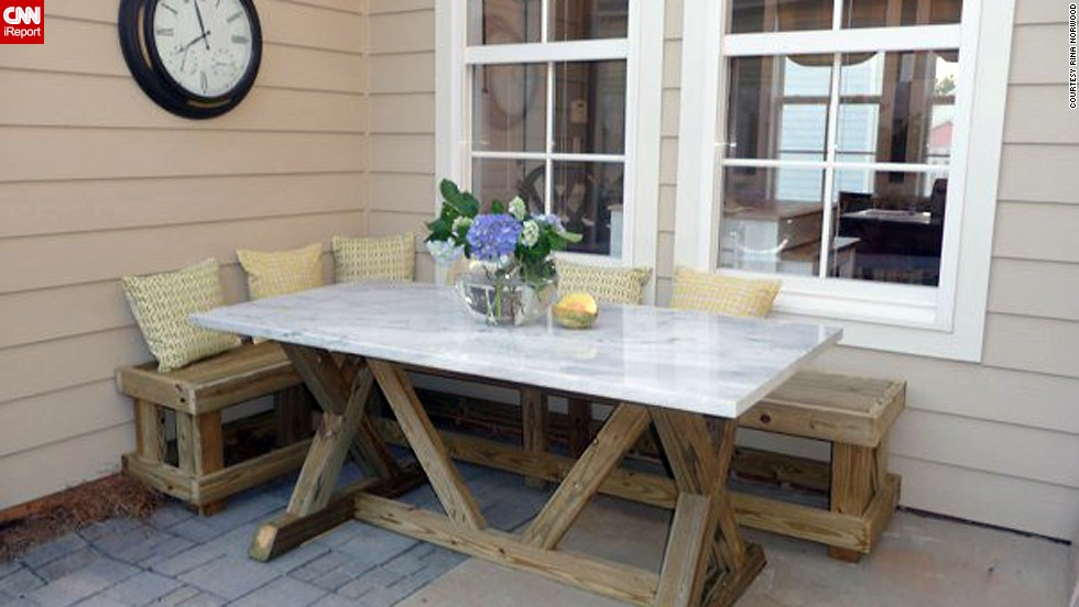 "<a href=""http://ireport.cnn.com/docs/DOC-1003865"">Rina Norwood</a> enjoys dining al fresco in the corner of her patio where she built a banquette and used salvage marble as a table top."