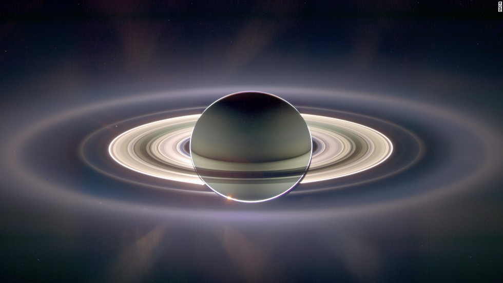 NASA's Cassini spacecraft has taken pictures of Saturn and Earth before. In this 2006 image, Earth is a tiny dot on the left, just to the inside of the second outer ring.