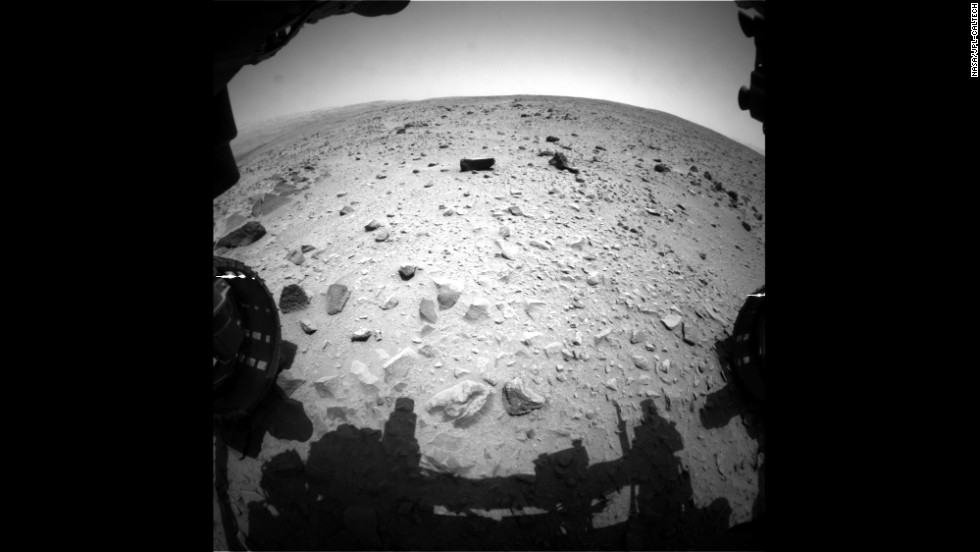 "Curiosity began a trek toward Mount Sharp after spending more than six months in the ""Glenelg"" area. This image was taken on July 16, 2013, after the rover passed the 1-kilometer mark for the total distance covered since the start of the mission."