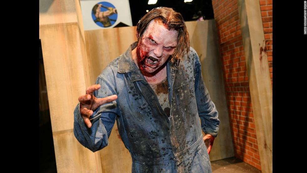 "A zombie character poses at ""The Walking Dead"" booth."