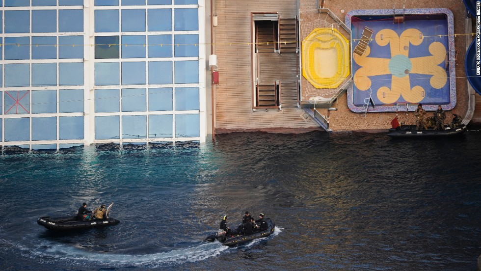 Military rescue workers approach the cruise liner on January 22, 2012.