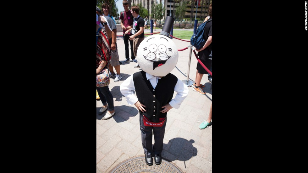 "A fan dressed as Pops from Cartoon Network's ""Regular Show"" poses for a photo on July 18."