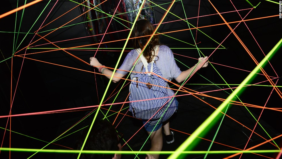 Attendees take part in Adult Swim's Fun House during Comic-Con on July 18.