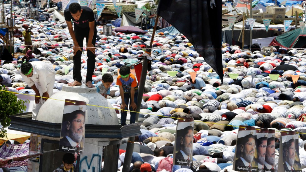 Supporters of Morsy pause for Friday prayers on July 19 at Nasr City in Cairo, where protesters have installed their camp and held daily rallies.