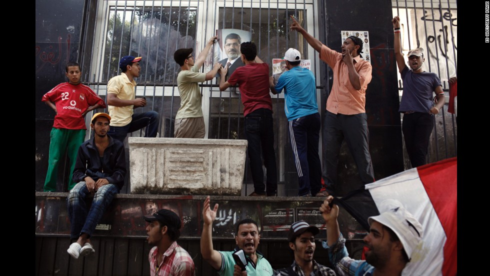 Morsy supporters take part in a protest march near government ministry buildings on Wednesday, July 17, in Cairo.