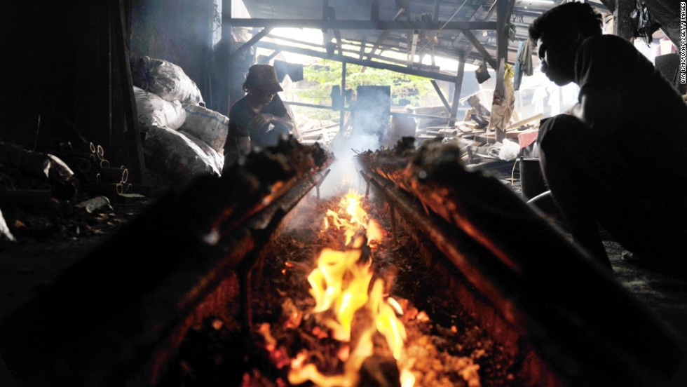 Men make lemang, a typical Indonesian food from West Sumatra made with sticky rice cooked in bamboo, in Jakarta, Indonesia, on July 18.