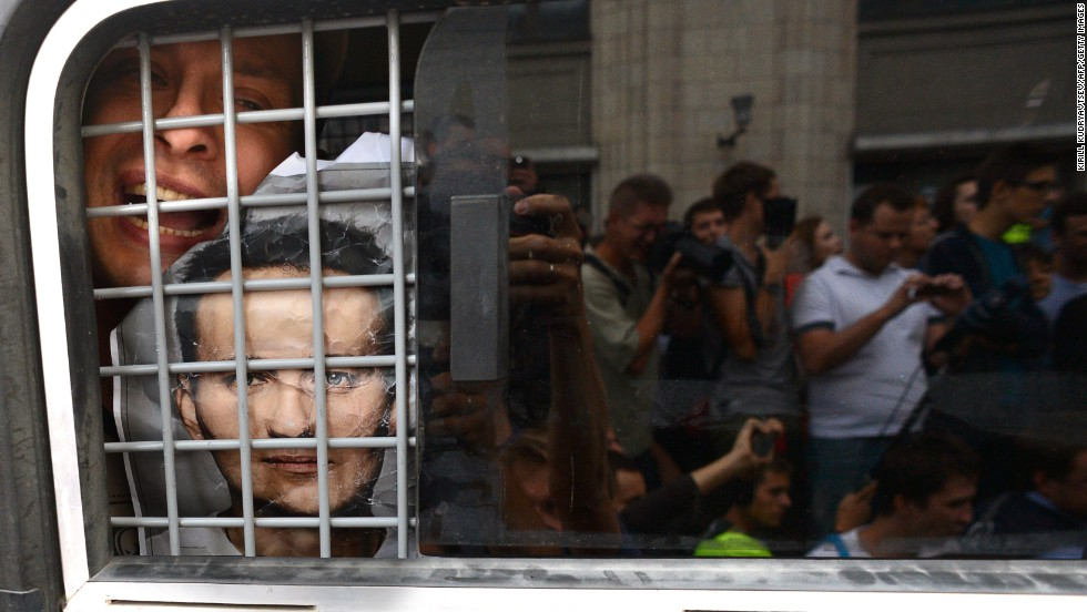"""JULY 19 - MOSCOW, RUSSIA: A supporter of convicted opposition leader Alexei Navalny is detained by police during a demonstration in Moscow. Navalny, one of president Vladimir Putin's most outspoken critics, was found <a href=""""http://cnn.com/2013/07/19/world/europe/russia-navalny-case/index.html?hpt=hp_t1"""">guilty of misappropriating funds</a>. The EU called the trial a sham."""