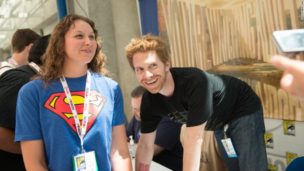 "Co-creator/executive producer Seth Green poses with a fan at the ""Robot Chicken"" signing for the Comic-Con International 2013 in San Diego on Thursday, July 18."