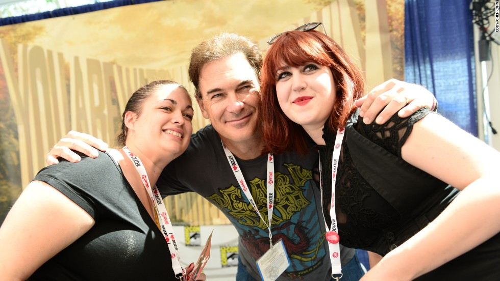 "Patrick Warburton poses with fans during Adult Swim's ""The Venture Bros."" signing on July 18."