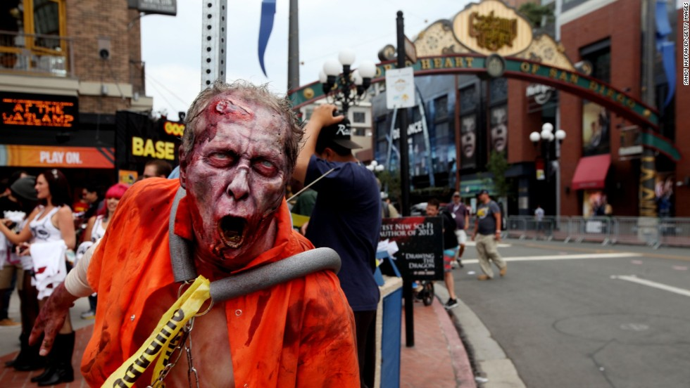 A zombie greets people as along 5th Avenue on July 19, in San Diego's Gaslamp Quarter during the convention.