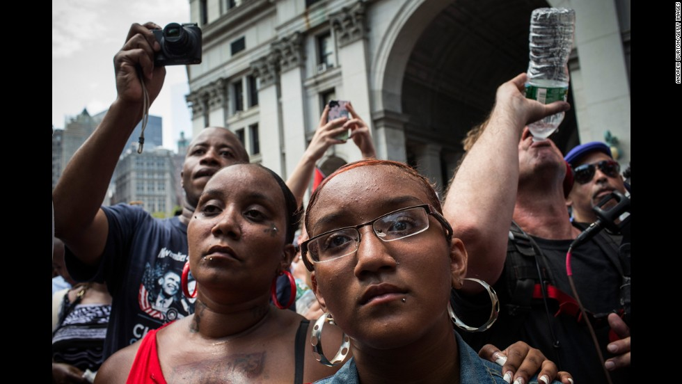 "Protesters attend a rally in support of Trayvon Martin, in New York  on July 20. The Rev. Al Sharpton's National Action Network organized the ""'Justice for Trayvon' 100 city vigil"" which called supporters to gather in front of federal buildings around the country on July 20, as a continued protest against the George Zimmerman verdict."
