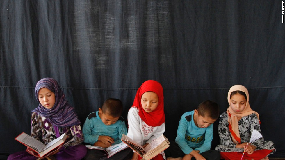 Children read the Quran at a mosque in Kabul, Afghanistan, on Sunday, July 21.