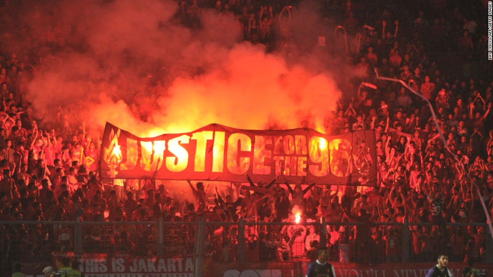 Liverpool's Indonesian fans show their support for the campaign to win justice for the families of the 96 people who died at Sheffield Wednesday's Hillsborough football ground on 15 April in 1989 during an FA Cup semifinal between the Merseyside club and Nottingham Forest.