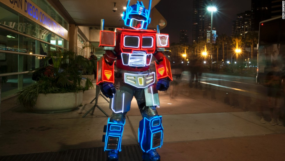 "A convention-goer dressed as Optimus Prime from the ""Transformers"" franchise walks outside of the convention center on July 20."