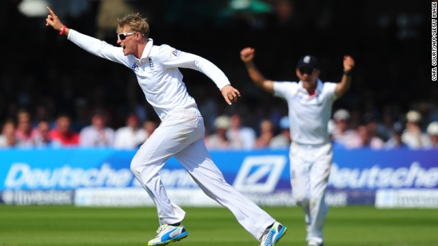 Joe Root (L) celebrates after taking the wicket of Australia's Usman Khawaja on the fourth day of the second Test.