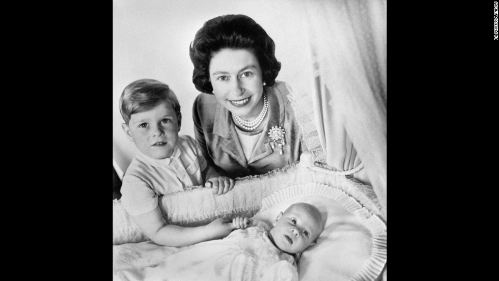 Queen Elizabeth II and Prince Andrew with newborn Prince Edward, the queen's fourth child, in Buckingham Palace's music room in June 1964.
